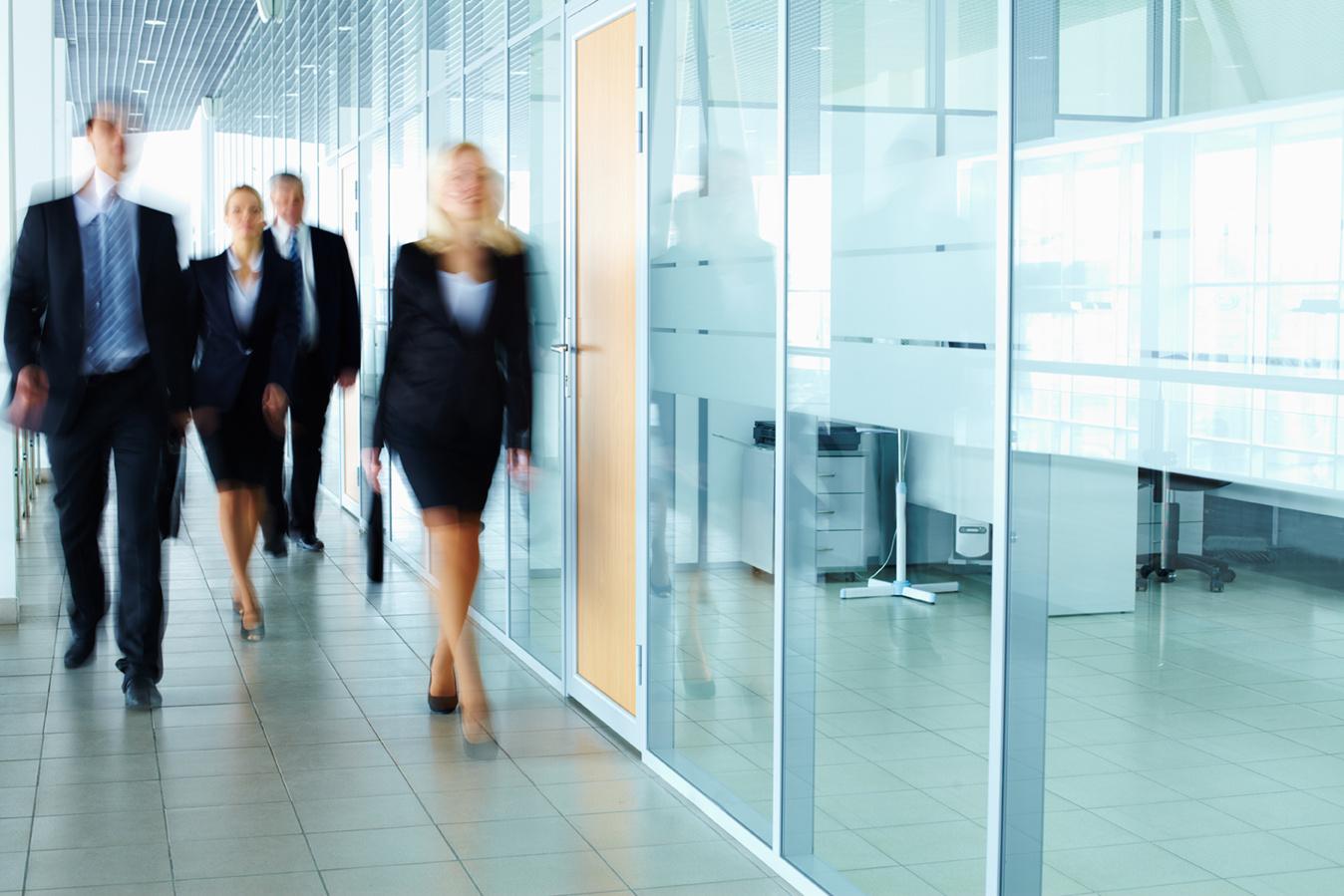 blurry people walking to meeting room